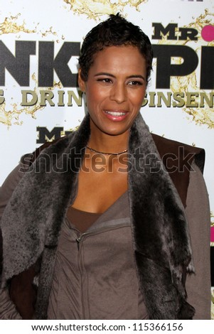 """LOS ANGELES - OCT 11:  Daphne Wayans arrives at the """"Mr. Pink"""" Energy Drink Launch at Beverly Wilshire Hotel on October 11, 2012 in Beverly Hills, CA - stock photo"""