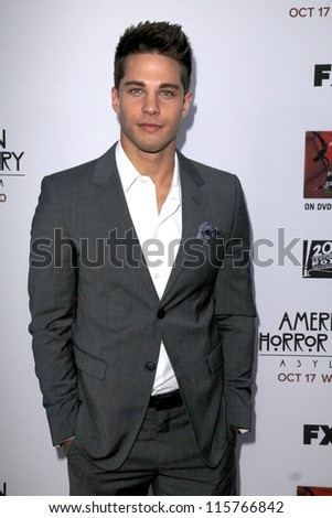 "LOS ANGELES - OCT 13:  Dean Geyer arrives at the ""American Horror Story: Asylum"" Premiere Screening at Paramount Theater on October 13, 2012 in Los Angeles, CA - stock photo"
