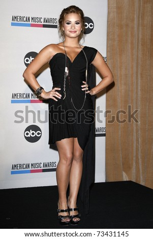 LOS ANGELES - OCT 12:  Demi Lovato arrives at the 2010 American Music Awards Nominations on October 12, 2010 in Los Angeles, CA - stock photo