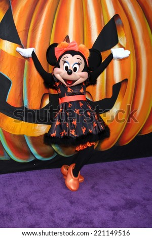 LOS ANGELES - OCT 1:  Minnie Mouse at the VIP Disney Halloween Event at Disney Consumer Product Pop Up Store on October 1, 2014 in Glendale, CA - stock photo