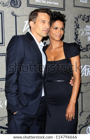LOS ANGELES - OCT 5:  Olivier Martinez, Halle Berry arrives at the Variety's 4th Annual Power Of Women Event at Beverly Wilshire Hotel on October 5, 2012 in Beverly Hills, CA - stock photo