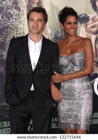 """LOS ANGELES - OCT 24:  Olivier Martinez & Halle Berry arriving to """"Cloud Atlas"""" Los Angeles Premiere  on October 24, 2012 in Hollywood, CA - stock photo"""