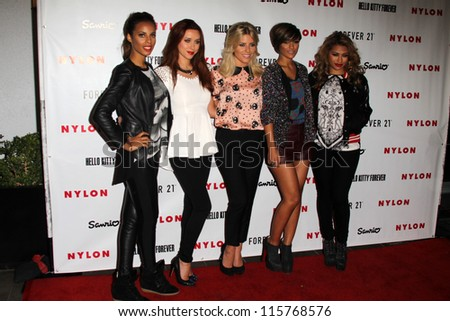 LOS ANGELES - OCT 15:  The Saturdays arrive at  Nylon's October IT Issue party at London West Hollywood on October 15, 2012 in Los Angeles, CA - stock photo
