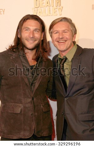 """LOS ANGELES- OCT 17: Zach McGowan and Sean Cameron Michael arrive at the """"Death Valley"""" film premiere Oct. 17, 2015 at Raleigh Studios in Los Angeles, CA. - stock photo"""