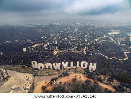 LOS ANGELES - October 2015: Hollywood Sign aerial view from behind with LA cityscape in the background on a gloomy day. - stock photo