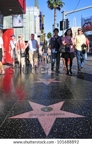 LOS ANGELES - OCTOBER 16: Hollywood Walk of Fame in Hollywood Boulevard on October 16, 2011 in Los Angeles. More than 2,400 five-pointed stars attracts about 10 million visitors annually - stock photo