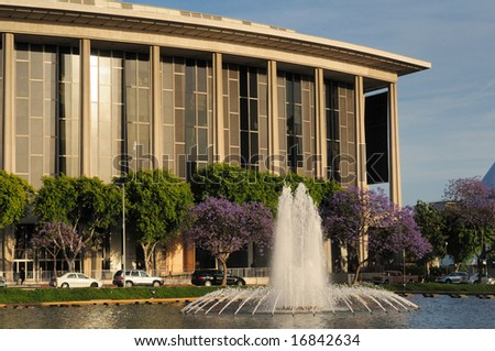Los Angeles opera house with trees and fountain in the foreground - stock photo
