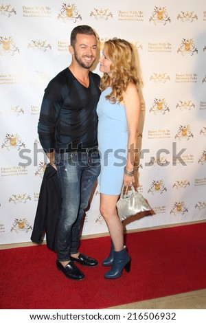 LOS ANGELES - SEP 10:  Artem Chigvintsev, Lea Thompson at the Dance With Me USA Grand Opening at Dance With Me Studio on September 10, 2014 in Sherman Oaks, CA - stock photo