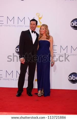 LOS ANGELES - SEP 23:  Jon Hamm, Jennifer Westfeldt arrives at the 2012 Emmy Awards at Nokia Theater on September 23, 2012 in Los Angeles, CA - stock photo