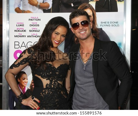 "LOS ANGELES - SEP 25:  Paula Patton, Robin Thicke at the ""Baggage Clain"" Premiere at Regal 14 Theaters on September 25, 2013 in Los Angeles, CA"