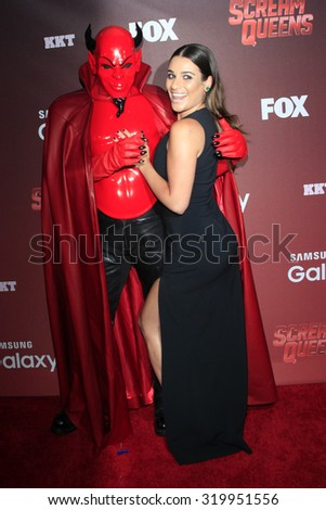 "LOS ANGELES - SEP 21:  Red Devil, Lea Michele at the Premiere of FOX TV's ""Scream Queens"" at the Wilshire Ebell Theater on September 21, 2015 in Los Angeles, CA - stock photo"