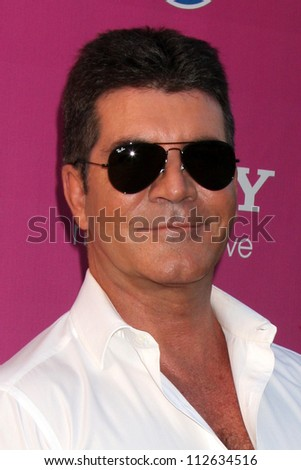 LOS ANGELES - SEP 11:  Simon Cowell arrives at the FOX Season 2 Premiere of X-Factor at Graumans Chinese Theater on September 11, 2012 in Los Angeles, CA - stock photo