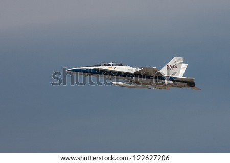 LOS ANGELES - SEPT 21: A NASA F-18 Hornet flies lo the ground on the Shuttle's arrival in Los Angeles on Sept 21, 2012 . - stock photo