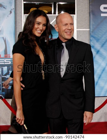 LOS ANGELES - SEPT 24: Bruce Willis and wife Emma Heming at the world premiere of 'Surrogates' on September 24, 2009 in Los Angeles, California - stock photo