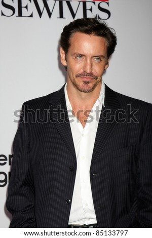 "LOS ANGELES - SEPT 21:  Charles Mesure arriving at the ""Desperate Housewives"" Final Season Kick-Off Party at Wisteria Lane, Universal Studios on September 21, 2011 in Los Angeles, CA"