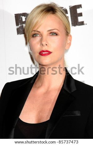 LOS ANGELES - SEPT 30:  Charlize Theron arriving at  the RAGE Game Launch at the Chinatown's Historical Central Plaza on September 30, 2011 in Los Angeles, CA - stock photo