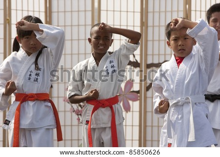 LOS ANGELES - SEPT 25:  Matsubayahsi-Ryu Karate of Little Tokyo perform traditional Karate at the Cherry Blossom Festival on September 25, 2011 in Los Angeles, CA. Unidentified kids - stock photo