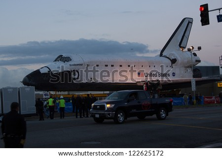 LOS ANGELES - SEPT 21: Shuttle Endeavour moves across the streets of Los Angeles on Oct 12, 2012. - stock photo