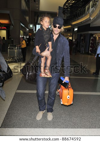 LOS ANGELES-SEPTEMBER 05: Model Gabriel Aubry and Mrs Halle Berry with daughter at LAX airport. September 05 in Los Angeles, California 2011 - stock photo