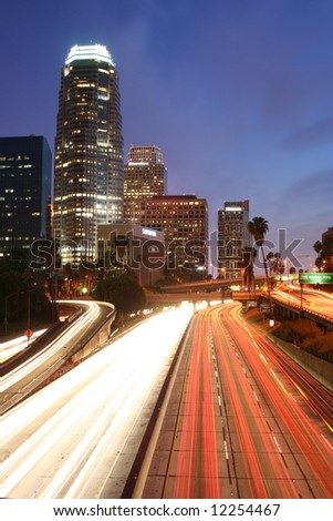 Los Angeles Skyline and Freeway at Night - stock photo