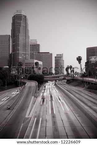 Los Angeles skyline and highway - stock photo