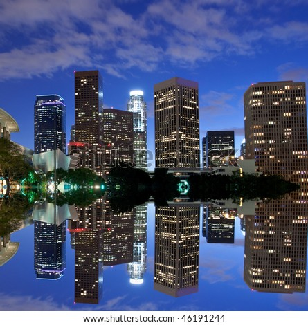 Los Angeles skyline and reflection at night - stock photo