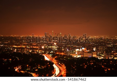 Los Angeles Skyline of Downtown with skyscrapers, urban buildings and traffic on Interstate 101 at night