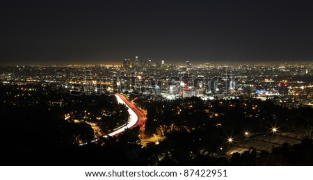 Los Angeles skyline viewed from Mulholland Drive at night. - stock photo