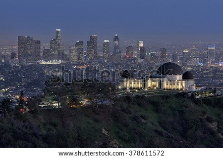 Los Angeles skyline with the Griffith Observatory in the foreground - stock photo