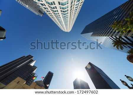 Los Angeles skyscrapers over blue sky background, wide angle view from below. - stock photo