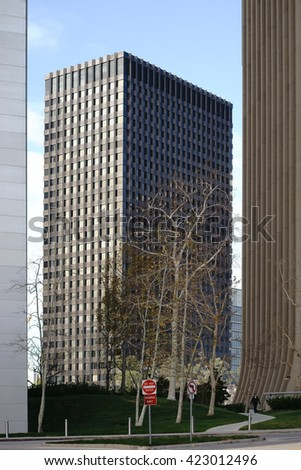 LOS ANGELES, UNITED STATES - DECEMBER 27: A passerby goes between different skyscrapers along a path in the city center and downtown on December 27, 2015 in Los Angeles / Downtown Los Angeles - stock photo