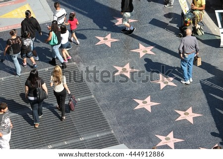 LOS ANGELES, USA - APRIL 5, 2014: People visit Walk of Fame in Hollywood. Hollywood Walk of Fame features more than 2,500 stars with inscribed celebrity names. - stock photo