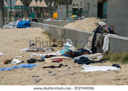 LOS ANGELES, USA - AUGUST 5, 2014 - homeless in venice beach in los angeles - stock photo