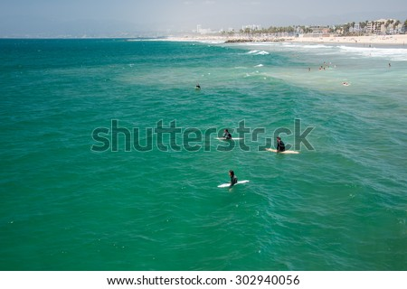 LOS ANGELES, USA - AUGUST 5, 2014 - people in venice beach landscape and baywatch tower in los angeles - stock photo