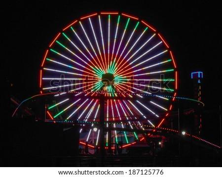 LOS ANGELES, USA - JANUARY 30, 2013: Amusement park lights at night in Los Angeles California - stock photo