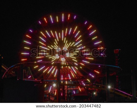 LOS ANGELES, USA - JANUARY 30, 2013: Pacific Park amusement park lights at night in Santa Monica Los Angeles California - stock photo