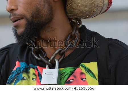 Los Angeles, USA - July 12, 2016 -  Black lives matter protestor wearing a chain with lock around his neck on City Hall following ruling on LAPD fatal shooting of African American female Redel Jones