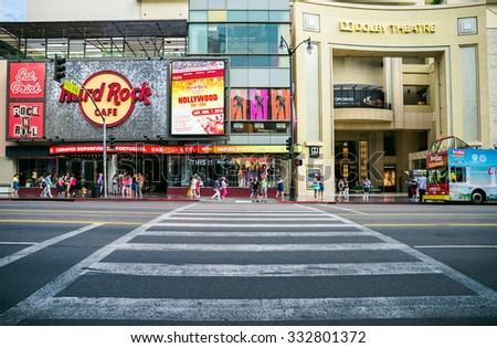 LOS ANGELES, USA - SEPTEMBER 12: Tourists walk on Hollywood Walk of Fame on September 12, 2015 in Hollywood, Los Angeles - California. There are over 2400 celebrity stars on Hollywood Blvd. - stock photo