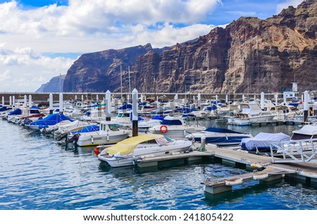 LOS GIGANTES, TENERIFE ISLAND - MAY 20, 2012: boats and yachts anchor in port Los Gigantes, ocean meets here highest cliffs on Tenerife island.