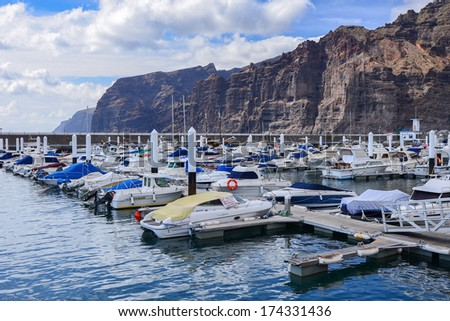 LOS GIGANTES, TENERIFE ISLAND - MAY 20: boats and yachts anchor in port Los Gigantes on 20th May 2012, ocean meets here highest cliffs on Tenerife island.