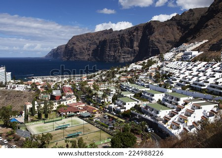 Los Gigantes - The town and harbour seen from the cliffs - stock photo