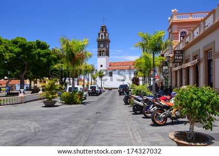 LOS SILOS, TENERIFE ISLAND - MAY 20: Main street of Los Silos town with church on main square on sunny day on 20th May 2012, Tenerife island, Spain
