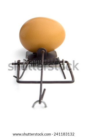 Lose-lose situation.  --  A mouse-trap using an egg as a bait. Attempting to get the egg will result in broken egg. Not attempting at all, will result in no egg at all. Lose-lose situation. - stock photo