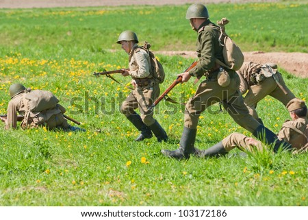 LOSHANY, BELARUS - MAY 9: military history club members in Soviet WWII uniform attack enemy positions during historical reenacting show at Stalin's Line memorial on May 09, 2012 in Loshany, Belarus - stock photo