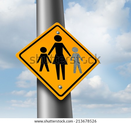Lost child or missing kid concept with a mother and children icon on a traffic sign with an empty paint spot as a symbol of parents  losing their children in a failed adoption or despair.