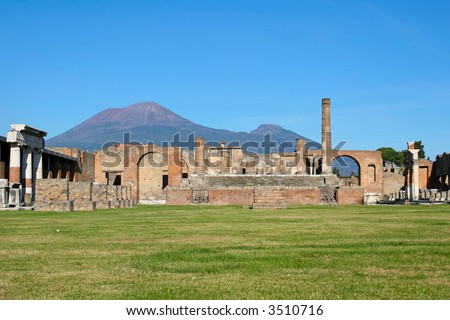 lost city of pompeii with mount vesuvius in the background - stock photo