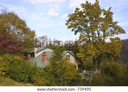lost in the woods high in mountains little single house - stock photo