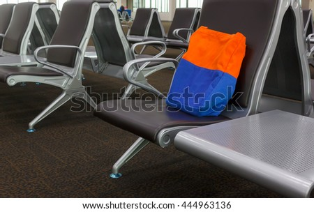 Lost luggage at lounge airport concept.Someone forget the bag cloth on the seat at lounge airport. - stock photo