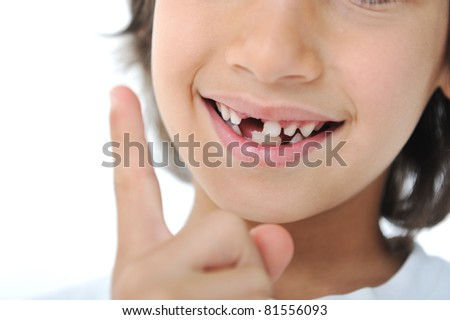 Lost milk tooth fairy, cute boy with long hair - stock photo