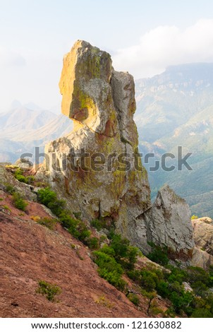 Lost Mine trail overlook of a rock outcropping in the Chisos Mountains at sunrise in Big Bend National Park - stock photo